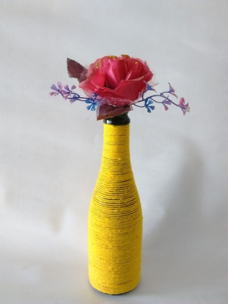 yellow yarn wrapped bottle with flower