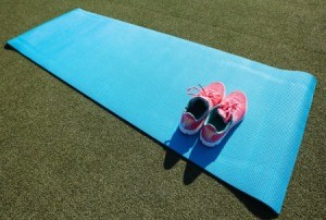 shoes on a yoga mat