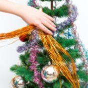 hand decorating tree