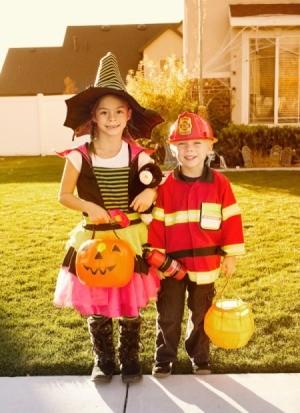 Kids trick or treating on Halloween.