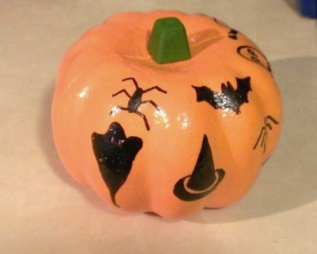 A foam pumpkin with marking pen decorations.