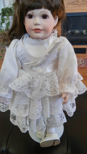 doll in lacy white dress