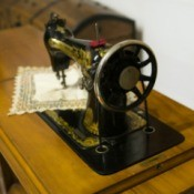 vintage sewing machine in wooden cabinet