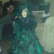 large doll in fancy green dress