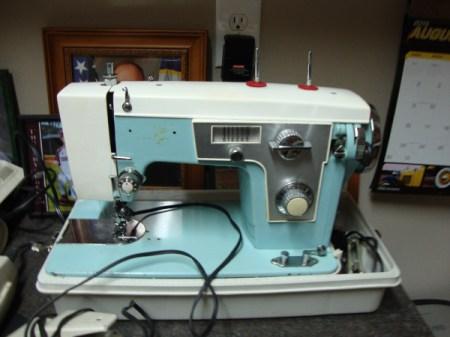 blue and beige sewing machine