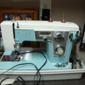 blue and beige sewing machine