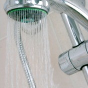 showerhead against tan wall