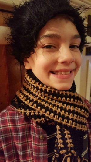 young boy wearing the scarf