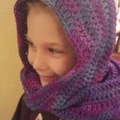 young girl wearing crochet hooded scarf