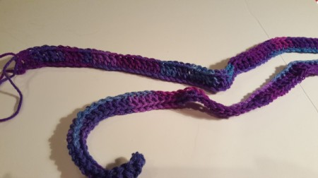 make a double crochet in the chain stitches for the hooded scarf