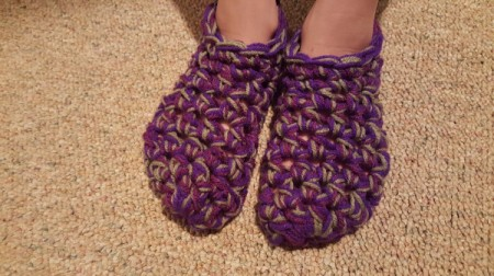 Thick Crocheted Slippers -  top down view of slippers on child's feet