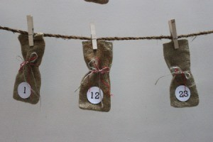 Three  burlap bags on a string, to use as an Advent calendar.