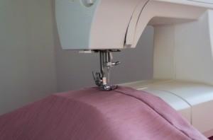 A sewing machine making repairs.