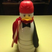 A penguin made from a decorated Coffeemate container.