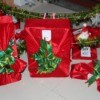 Fabric Wrapping Paper - variety of gifts wrapped in red stretch velvet with green bows