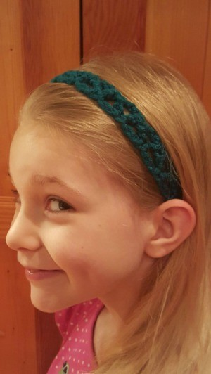 young girl wearing headband