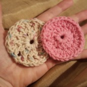 two finished crochet facial rounds