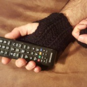 Crochet Men's Fingerless Gloves - person wearing gloves using a remote