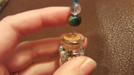 Message in a Bottle Pendant - put a drop of glue on cork and insert head pin