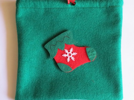 felt stocking decoration added to bag