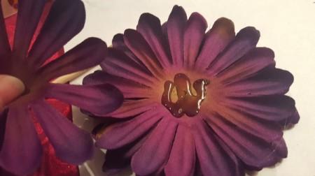 add glue to back of flower