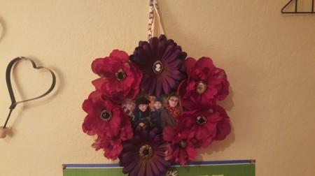 photo wreath hanging on wall