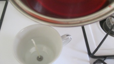 Teacup Candle - pouring leftover wax into cup with wick