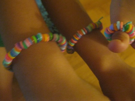 Melted Perler Beads - melted bead brackets on child's wrist, ankle, and thumb