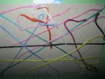 random yarn painting project in progress