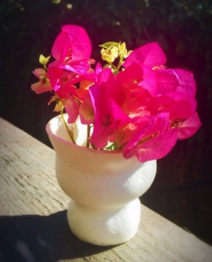 cup vase with flowers