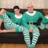 dad and sons wearing elf pjs