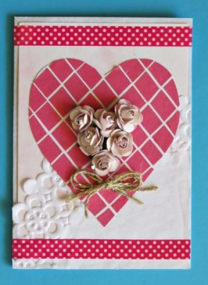 A Valentine's day card with a heart, mesh, lace and flowers.