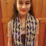 young girl wearing cowl down