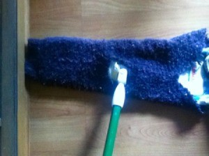 sweater arm as reusable dust mop cover
