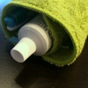 Washcloth Travel Toothbrush  Holder - with toothpaste tube showing