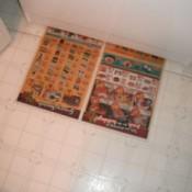 newspaper on floor in front of freezer