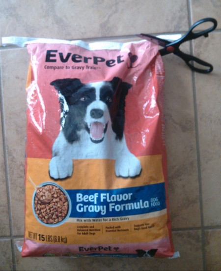 cutting off top of bag to empty before making tote from dog food bag