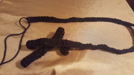single crochet in chain stitches for scarf fasten off and leave a long tail