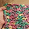 Lacy Crocheted Dishcloth - hand holding finished multicolor cloth