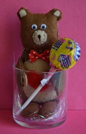 felt Teddy bear holding Dum Dum
