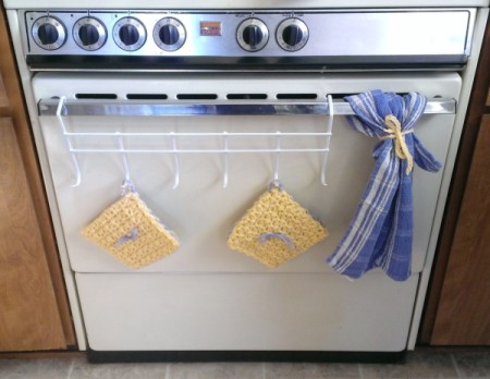 hot pads and towel hanging on oven door