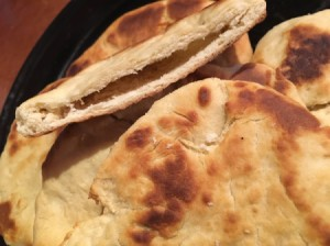 A plate of homemade pita rounds.