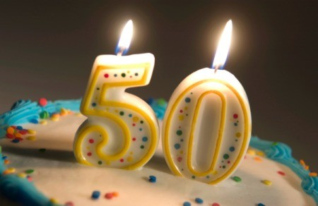 50th birthday party numbered candles on a cake