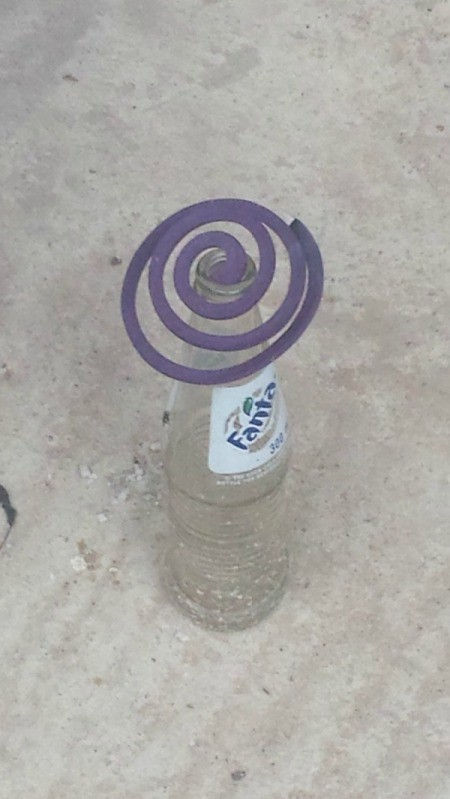 coil in soda bottle