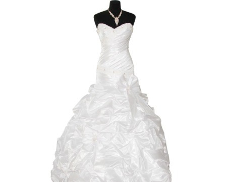 White wedding dress on black dress form against white background