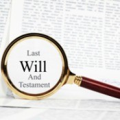 "Legal document with magnifying glass highlighting the words ""Last Will and Testament"""