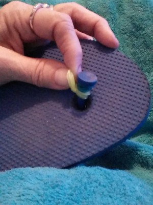 A rubber band around the center thong of a flip flop.