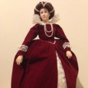 doll in fancy dark red dress over petticoats