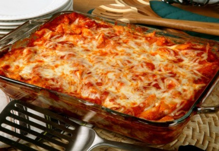 Glass rectangular pan on baked ziti cooling on electric stove top