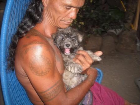 man holding Bichon Frise puppy